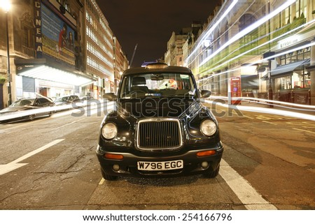 LONDON - DEC 03 : TX1 Hackney Carriage, also called London Taxi or Black Cab, at Strand on Dec 3, 2012 in London, UK. TX1 is manufactured by the London Taxis International, LTI  - stock photo