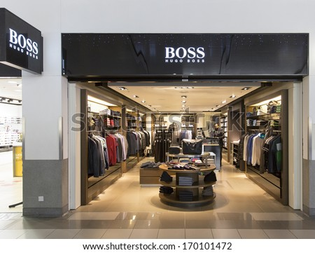 LONDON  DECEMBER 16: A Boss store December 16, 2013 Heathrow, London, England. Based in Metzingen in Germany it has 12,000 staff, 840 own stores and 2012 sales of EUR 2.3 billion in 129 countries.