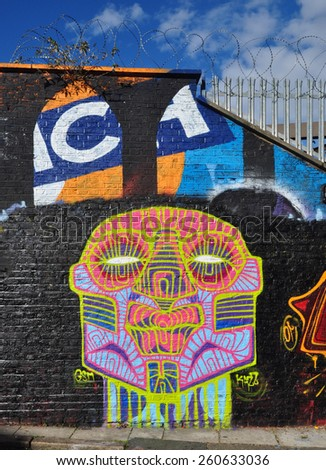 LONDON - DECEMBER 28, 2014. A wall painting at Pedley Street, just off Brick Lane, Shoreditch, in the Borough of Tower Hamlets, an area renown for street art in east London, UK. - stock photo
