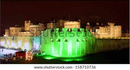 "LONDON - DECEMBER 21 : Front wall of the castle ""Tower of London"" pictured on December 21th, 2005, in London, UK. Located the bank of the Thames, it was built in 1066 by William the Conqueror.  - stock photo"