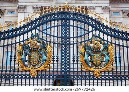LONDON - DECEMBER 23: Gate of Buckingham palace on December 23, 2014 in London U.K. Buckingham palace is the official residence of Queen Elizabeth II and one of the major tourist destinations U.K. - stock photo