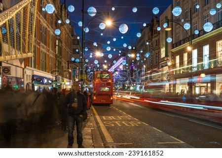 LONDON - DECEMBER 21st 2014: Christmas lights on Oxford Street, London, UK. The full length of the busiest shopping area in central London is decorated with 1778 glowing white orbs. - stock photo