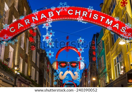 LONDON - DECEMBER 29th 2014: Carnaby Street is one of the most famous and popular shopping areas of London, it celebrates Christmas with some of the most spectacular Christmas lights in the capital.  - stock photo