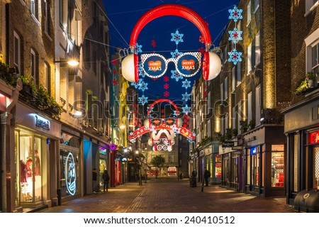 LONDON - DECEMBER 29th 2014: Christmas lights on Carnaby Street, London UK. Carnaby Christmas lights feature some of the most unusual Christmas decorations and lights in London. - stock photo