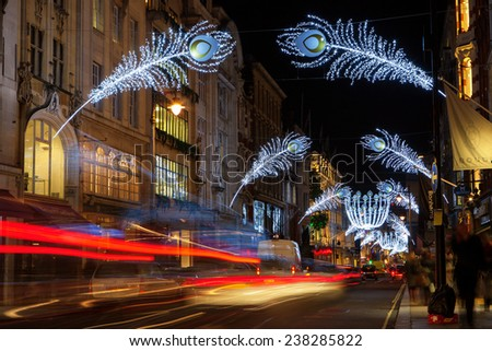 LONDON - DECEMBER 16th 2014: Christmas lights on New Bond Street, London, UK.The busy shopping area in central London gets decorated before Christmas.