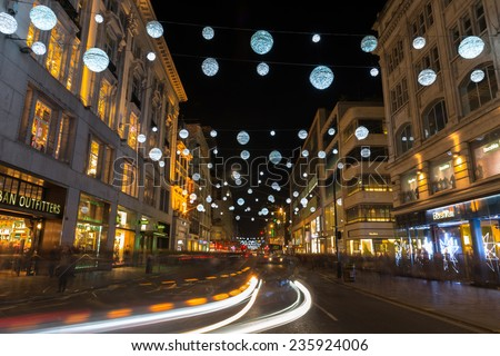 LONDON - DECEMBER 6th 2014: Christmas lights on Oxford Street, London, UK. The  full length of the busiest shopping area in central London is decorated with 1778 glowing white orbs. - stock photo