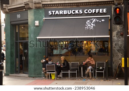 LONDON - DECEMBER 11TH: The exterior of a starbucks coffee shop on December the 11th, 2014, in London, England, UK. Starbucks has 15000 stores worldwide. - stock photo