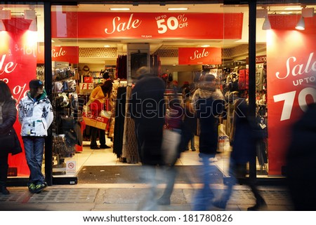 LONDON - DECEMBER 26: The famous Oxford Street pack with crowds of tourists and locals doing their last minute Christmas shopping on December 26, 2011 in London, United Kingdom.  - stock photo