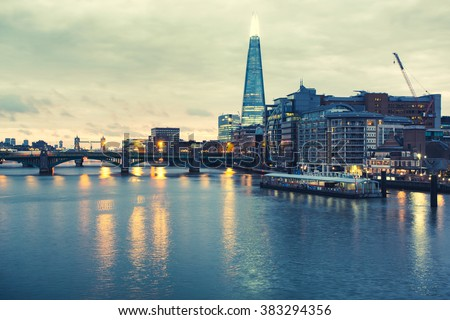 LONDON, DECEMBER 12, 2015 : The Shard in London on DECEMBER 12, 2015. View from Tower Bridge towards City Hall and The Shard skyscraper at Southwark in London on DECEMBER 12, 2015. United Kingdom. - stock photo