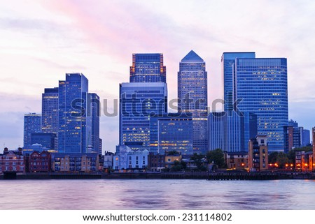 London Docklands financial district cityscape on a colorful evening - stock photo