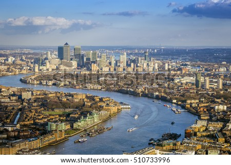 London, England - Aerial view of the skyscrapers of Canary Wharf, the leading business district of the world and River Thames