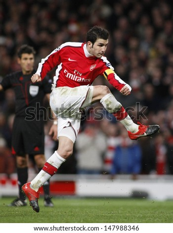 LONDON, ENGLAND. 31/03/2010. Arsenal player Cesc Fabregas (captain) taking and scoring a penalty  during the  UEFA Champions League quarter-final between Arsenal and Barcelona at the Emirates Stadium - stock photo