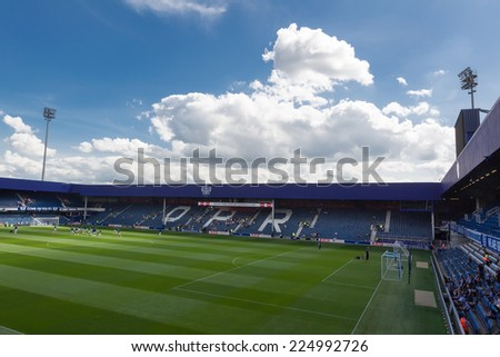 LONDON, ENGLAND - AUG 9, 2014 : Interior view of the empty Loftus Road Stadium before the friendly match QPR vs Paok. Loftus Road Stadium is the home base of the football team QPR.