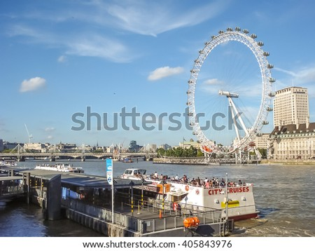 London, England - aug 21, 2011: London Eye at the River Thames. The giant ferris wheel was constructed for 2000 years celebrations. Major London landmark that continuously turns carrying many tourists