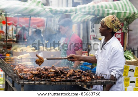 LONDON, ENGLAND - AUGUST 28: Food's stall at the Notting Hill Carnival on August 29, 2011 in London, England. Jerk Chicken Caribbean Specialty - stock photo