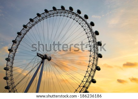 LONDON, ENGLAND, AUGUST 15: London Eye at Dusk in Westminster by the Thames River in London. England, London, 2010 - stock photo