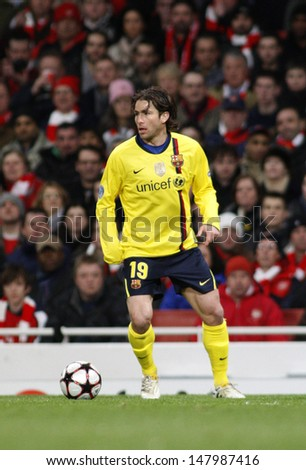 LONDON, ENGLAND. 31/03/2010. Barcelona player Maxwell in action during the  UEFA Champions League quarter-final between Arsenal and Barcelona at the Emirates Stadium - stock photo