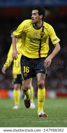 LONDON, ENGLAND. 31/03/2010. Barcelona player Sergio Busquets in action during the  UEFA Champions League quarter-final between Arsenal and Barcelona at the Emirates Stadium - stock photo