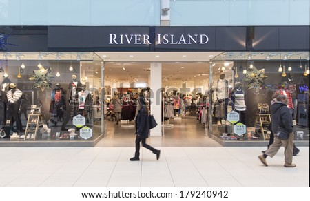 LONDON, ENGLAND -Â?Â? DECEMBER 13, 2013: A branch of River Island. The chain retails affordable fashion and has 300 stores across the UK, Ireland and internationally. - stock photo
