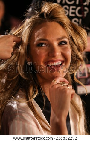LONDON, ENGLAND - DECEMBER 02: Candice Swanepoel poses backstage at the annual Victoria's Secret fashion show at Earls Court on December 2, 2014 in London, England. - stock photo