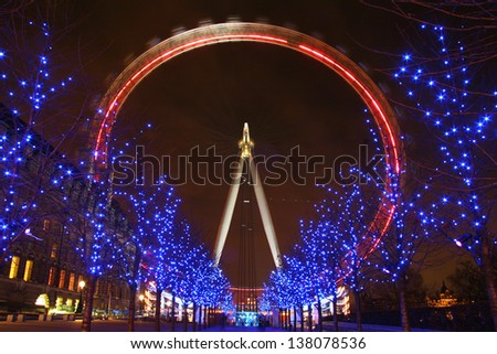 LONDON, ENGLAND - DECEMBER 21: London Eye on December 21th 2005 in London. The 135 meter landmark is a giant Ferris wheel situated on the banks of the River Thames in London, England. - stock photo
