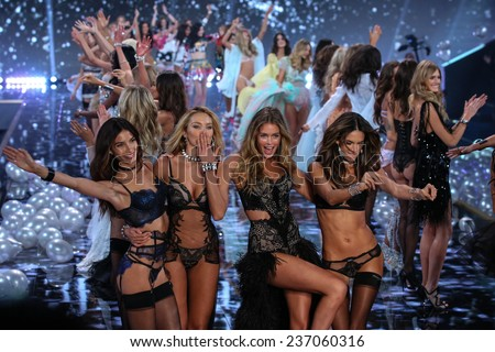 LONDON, ENGLAND - DECEMBER 02:   Models (L-R) Lily Aldridge, Candice Swanepoel, Doutzen Kroes and Alessandra Ambrosio during 2014 VS Fashion Show on December 2, 2014 in London, England. - stock photo