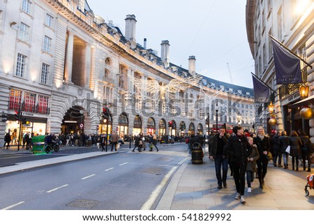 LONDON, ENGLAND - DECEMBER 18, 2016: People walking in the Piccadilly Circus and Regent street during Christmas time. The Piccadilly Circus was build in 1819 to connect Regent Street with Piccadilly.