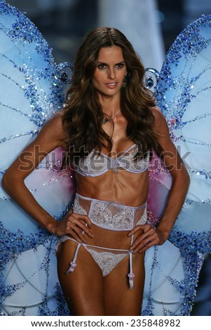 LONDON, ENGLAND - DECEMBER 02: Victoria's Secret model Izabel Goulart walks the runway during the 2014 Victoria's Secret Fashion Show on December 2, 2014 in London, England. - stock photo