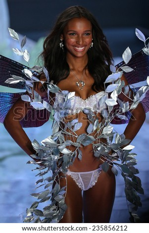 LONDON, ENGLAND - DECEMBER 02: Victoria's Secret model Jasmine Tookes walks the runway during the 2014 Victoria's Secret Fashion Show on December 2, 2014 in London, England. - stock photo