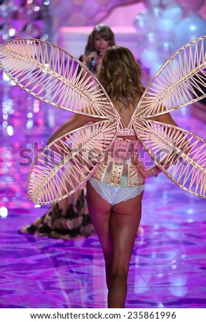 LONDON, ENGLAND - DECEMBER 02: Victoria's Secret model Karlie Kloss walks the runway during the 2014 Victoria's Secret Fashion Show on December 2, 2014 in London, England. - stock photo