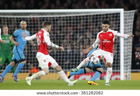 LONDON, ENGLAND - FEBRUARY 23: Aaron Ramsey and Alex Oxlade-Chamberlain of Arsenal during the Champions League match between Arsenal and Barcelona at The Emirates Stadium  - stock photo