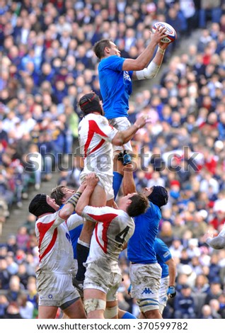 LONDON, ENGLAND-FEBRUARY 10, 2007: italian rugby player Sergio Parisse catching the ball in touche, during the Six Nations rugby tournament match England vs Italy, in London. - stock photo
