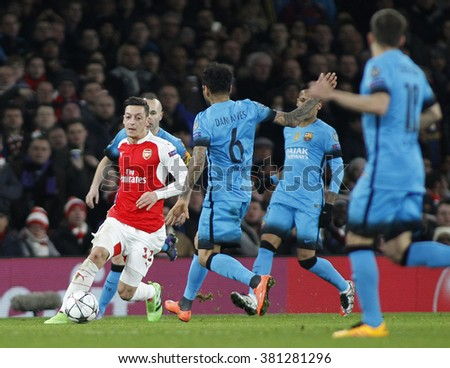 LONDON, ENGLAND - FEBRUARY 23: Mesut Ozil of Arsenal during the Champions League match between Arsenal and Barcelona at The Emirates Stadium  - stock photo