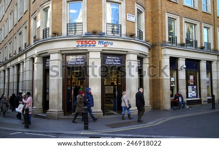 London, England - January 24, 2015: Pedestrians pass by the Tesco Metro store near Covent Garden in London, England. Tesco was founded in 1919 by Jack Cohen as a market stall in London's East End.