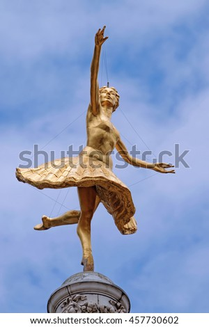 LONDON, ENGLAND - JULY 8, 2016: A gilded statue of ballerina Anna Pavlova above the cupola of the Victoria Palace Theater, London - stock photo