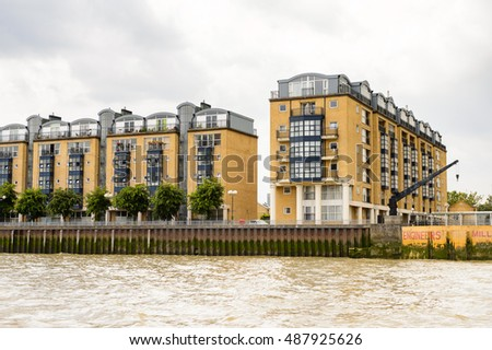 LONDON, ENGLAND - JULY 22, 2016: Beautiful view of the architecture on the bank of the river Thames in London, the capital of Great Britain