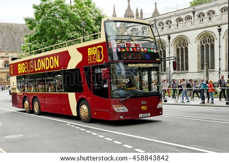 LONDON, ENGLAND - JULY 8, 2016: Big Bus Company sightseeing tour near Westminster Abbey. More than 30 Million people visit London every year. - stock photo