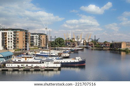 LONDON, ENGLAND - JULY 15: Blackwall Basin, near Canary Wharf on July 15, 2014 in London, England - stock photo