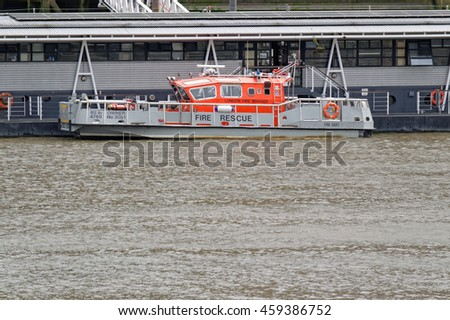 LONDON, ENGLAND - JULY 8, 2016: Fire brigade boat at the Thames river, London - stock photo