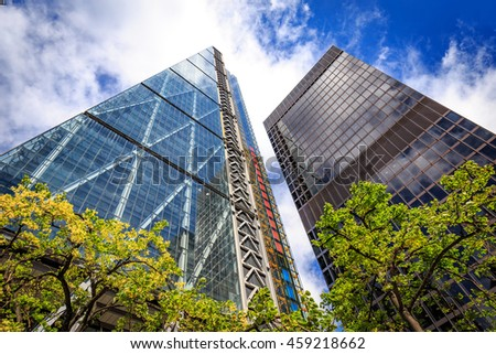 LONDON, ENGLAND - JULY 20,2016. 122 Leadenhall Street tower and Lloyd's building in City of London, UK. Both designed by the awarded British architectural firm Rogers Stirk Harbour and Partners.