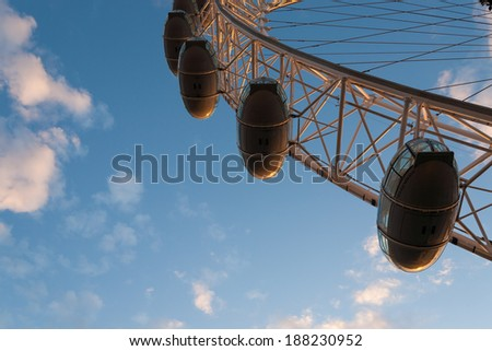 London, England - July 21, 2008: London Eye capsule seen from the just below. London Eye is also known as the Millennium Wheel, one of the most popular tourist attraction in London. - stock photo