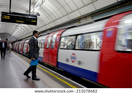 """LONDON, ENGLAND  - 27 July 2014 : London's underground train service, or """"Tube"""", is relied on by commuters and businessmen every day. - stock photo"""