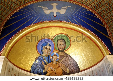LONDON, ENGLAND - JULY 8, 2016: Mosaics depicting the Holy Family of Jesus, Mary and Joseph, in the Chapel of St. Joseph in Westminster Cathedral. The Chapel is dedicated to the husband of Mary Joseph - stock photo