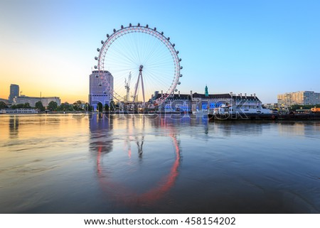 LONDON, ENGLAND - JULY 3, 2016 : The London Eye at sunrise on the South Bank of the River Thames at sunrise in London, England.