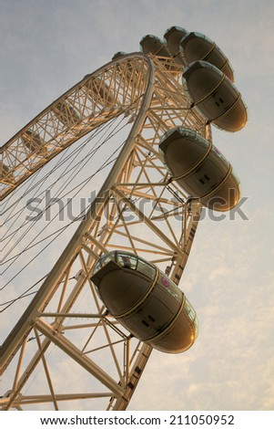 LONDON, ENGLAND, JULY 15: The London Eye is a giant Ferris wheel situated on the banks of the River Thames, in London, England, United Kingdom 2010. - stock photo