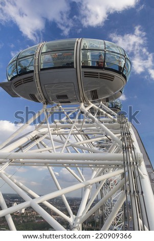 LONDON, ENGLAND - JULY 15: The London Eye, which receives over 3.5 million visitors a year on July 15, 2014 in London, England - stock photo