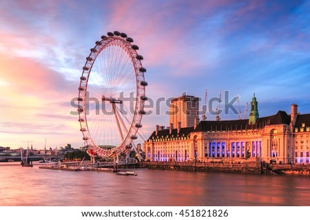 LONDON, ENGLAND - JULY 03,2016. View of City Of London at sunset with London Eye the biggest attraction in London. - stock photo