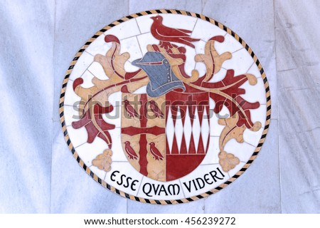 LONDON, ENGLAND - JULY 8, 2016: Westminster Cathedral interior. Coat of arms with latin inscription ESSE QUAM VIDERI, whitch is (or was) the motto of a number of schools and colleges around the world. - stock photo
