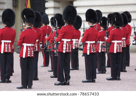 LONDON, ENGLAND- JUNE 21: Changing of the Grenadier Guards outside of Buckingham Palace on June 21, 2009 in London, United Kingdom. The Grenadier Guards traces its lineage back to 1656.