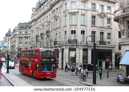 LONDON,ENGLAND,June 17, 2015: Double Decker bus driving through the busy streets of London England on June 17, 2015 - stock photo
